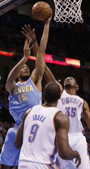 Denver&#039;s Anthony Randolph (15) drives against Oklahoma City&#039;s Kevin Durant (35) and Serge Ibaka (9) during the NBA basketball game between the Oklahoma City Thunder and the Denver Nuggets at the Chesapeake Energy Arena on Wednesday, Jan. 16, 2013, in Oklahoma City, Okla.  Photo by Chris Landsberger, The Oklahoman