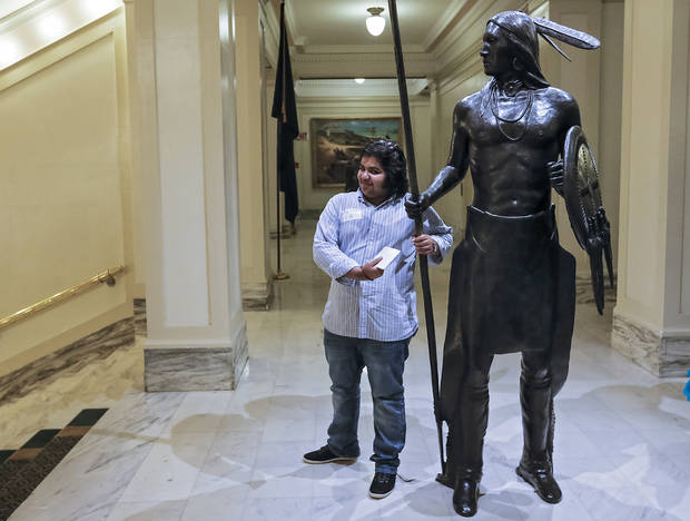 Naifal Kaldy, of Saudi Arabia, poses for a photo with a statue during International Student Awareness Day at the state Capitol on Monday, April 8, 2013, in Oklahoma City, Okla. International students from across the state joined legislators for the session wordy to see government in action. Photo by Chris Landsberger, The Oklahoman