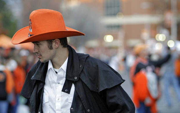 Alden Armstrong wears his orange cowboy hat in the &#039;Spirit Walk&#039; before the Bedlam college football game between the Oklahoma State University Cowboys (OSU) and the University of Oklahoma Sooners (OU) at Boone Pickens Stadium in Stillwater, Okla., Saturday, Dec. 3, 2011. Photo by Chris Landsberger, The Oklahoman