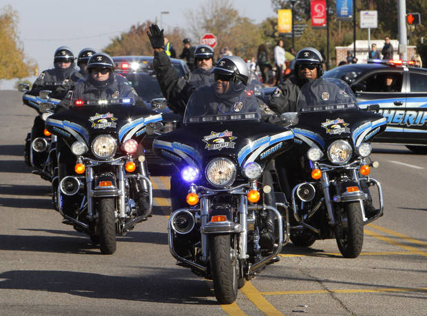 The Oklahoma County Sheriff's Dept. ride in formation during the University of Central Oklahoma's homecoming parade in Edmond, OK, Saturday, November 3, 2012,  By Paul Hellstern, The Oklahoman