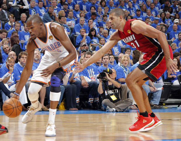 Miami's Shane Battier (31) guards Oklahoma City 's Kevin Durant (35) between the Oklahoma City Thunder and the Miami Heat at Chesapeake Energy Arena in Oklahoma City, Tuesday, June 12, 2012. Photo by Chris Landsberger, The Oklahoman