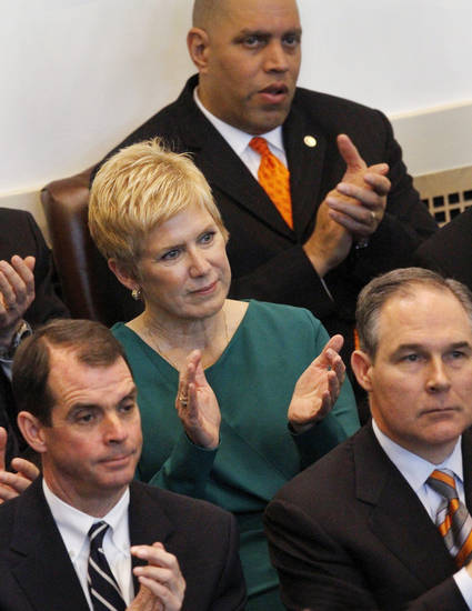 State Superintendent Janet Barresi, center, applauds while sitting among other members of Gov. Fallin's cabinet during her speech. Oklahoma Gov. Mary Fallin delivers her State of the State address to lawmakers Monday afternoon, Feb. 4, 2013, in the House of Representatives chamber. Also attending were members of the governor's cabinet and members of the judiciary.   Photo by Jim Beckel, The Oklahoman