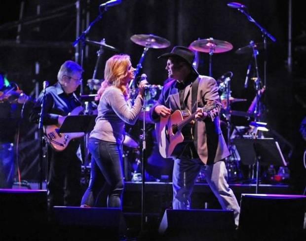 Trisha Yearwood and Garth Brooks perform at the tribute concert for the late George Jones, Friday, Nov. 22, 2013, in Nashville, Tenn. Jones had originally scheduled his final show for Friday. He died April 26. (AP file)