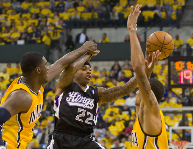   Sacramento Kings&#039; Isaiah Thomas passes off against the Indiana Pacers during the first half of an NBA basketball game in Indianapolis on Saturday, Nov. 3, 2012. (AP Photo/Doug McSchooler)  