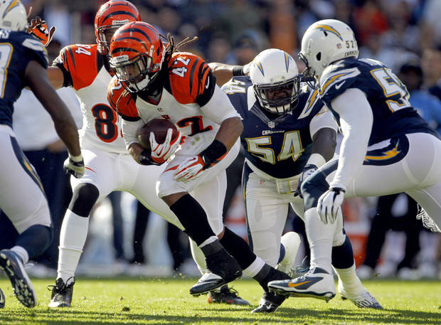 Cincinnati Bengals running back BenJarvus Green-Ellis runs upfield against the San Diego Chargers during the first half of an NFL football game, Sunday, Dec. 2, 2012, in San Diego. (AP Photo/Lenny Ignelzi )