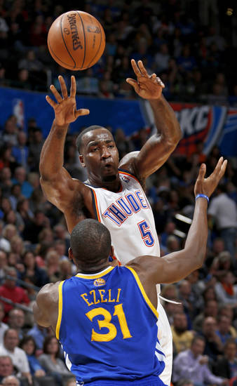 Oklahoma City's Kendrick Perkins (5) passes the ball over Golden State's Festus Ezeli (31) during an NBA basketball game between the Oklahoma City Thunder and the Golden State Warriors at Chesapeake Energy Arena in Oklahoma City, Wednesday, Feb. 6, 2013. Photo by Bryan Terry, The Oklahoman