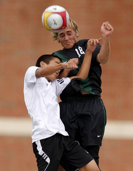 Norman North's Redford Jones, at right, and Tulsa Union's Van Horne go for the ball during the boys 6A state championship soccer game in Newcastle, Okla., Saturday, May 12, 2012. Photo by Bryan Terry, The Oklahoman