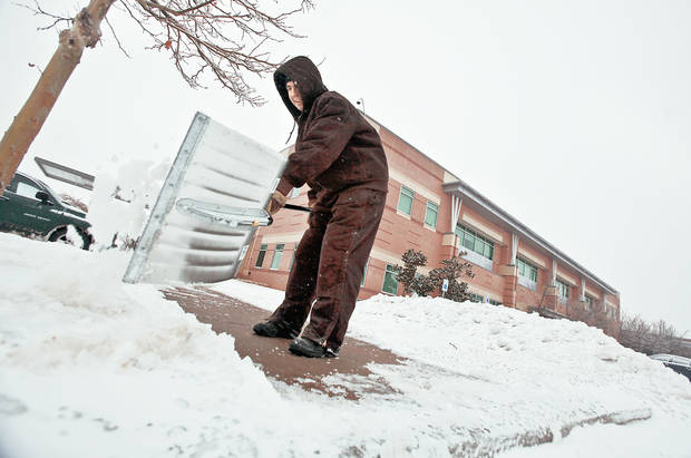 Left: John McBride uses a shovel Friday  to clear the sidewalks and parking lots of ice and snow at Integris Canadian Valley Hospital  in Yukon. Photo by Chris Landsberger, The Oklahoman   Online: To watch videos that show how Oklahomans coped with Friday's stormy weather, go to NewsOK.com/news/severeweather.