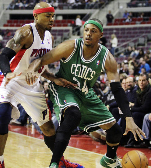 Boston Celtics forward Paul Pierce, right, drives against Detroit Pistons forward Corey Maggette (50) in the first half of an NBA basketball game, Sunday, Nov. 18, 2012, in Auburn Hills, Mich. (AP Photo/Duane Burleson)