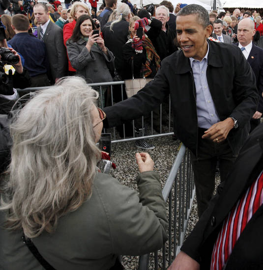 President Barack Obama speaks with Donna Schoenkopf of Tecumseh after he spoke about energy at the TransCanada Pipe Yard near Cushing, Okla., Thursday, March 22, 2012. Photo by Nate Billings, The Oklahoman
