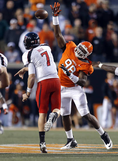 Oklahoma State's Davidell Collins (98) pressures Texas Tech's Seth Doege (7) during a college football game between Oklahoma State University and the Texas Tech University (TTU) at Boone Pickens Stadium in Stillwater, Okla., Saturday, Nov. 17, 2012. Photo by Sarah Phipps, The Oklahoman