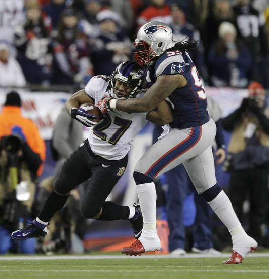 Baltimore Ravens running back Ray Rice (27) is tackled by New England Patriots linebacker Mike Rivera during the first half of the NFL football AFC Championship football game in Foxborough, Mass., Sunday, Jan. 20, 2013. (AP Photo/Matt Slocum)