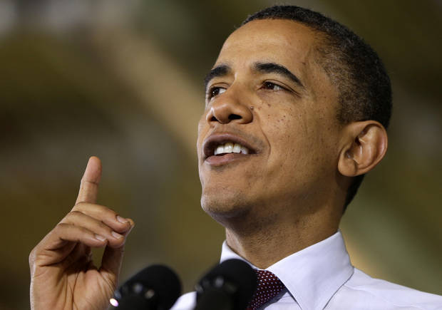 President Barack Obama gestures as he speaks to workers during a visit to the Daimler Detroit Diesel plant in Redford, Mich., Monday, Dec. 10, 2012. (AP Photo/Charles Dharapak)