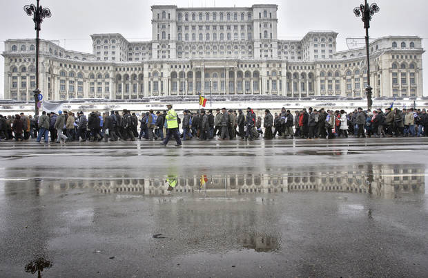 FILE - A Jan. 24, 2011 file photo shows the Parliament Palace in Bucharest, Romania. Twenty-three years after communism collapsed, the Palace of the Parliament, a gargantuan Stalinist symbol and the most concrete legacy of ex-dictator Nicolae Ceausescu, has emerged as an unlikely pillar of Romania's nascent democracy. And while it remains one of the most controversial projects of Ceausescu's 25-year rule, albeit one that has gradually found a place in the nation's psyche, it's also now a tourist attraction, visited by tens of thousands of Romanians and foreigners every year. (AP Photo/Vadim Ghirda, File)