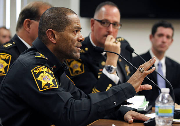 FILE - In this Oct. 11, 2012 file photo, Milwaukee County Sheriff David Clarke talks during a budget hearing in Milwaukee, Wis. The Wisconsin sheriff said he released an ad calling on residents to defend themselves because the old model of having a citizen call 911 and wait for help isn't always the best option. (AP Photo/Milwaukee Journal-Sentinel, Gary Porter)