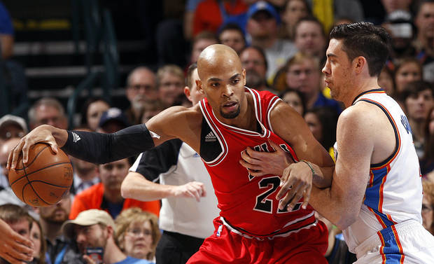 Oklahoma City's Nick Collison (4) defends against Chicago's Taj Gibson (22) during the NBA game between the Oklahoma City Thunder and the Chicago Bulls at Chesapeake Energy Arena in Oklahoma City, Sunday, Feb. 24, 2013. Photo by Sarah Phipps, The Oklahoman