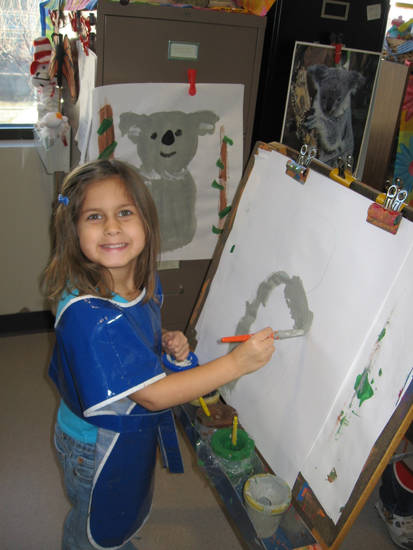 Shellby Loftis enjoys painting a koala on the easel.<br/><b>Community Photo By:</b> Susan Potter<br/><b>Submitted By:</b> Susan, Yukon
