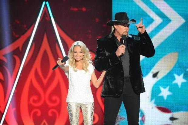 Kristin and Trace appear onstage together.