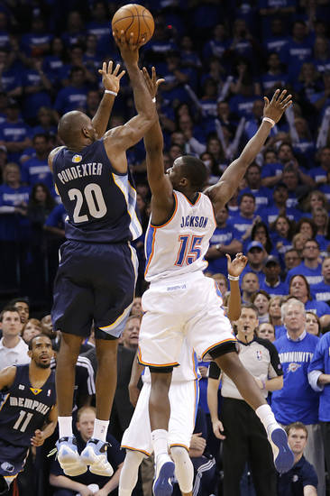 Oklahoma City's Reggie Jackson (15) fouls Memphis' Quincy Pondexter (20) on a three point shot during the second round NBA playoff basketball game between the Oklahoma City Thunder and the Memphis Grizzlies at Chesapeake Energy Arena in Oklahoma City, Sunday, May 5, 2013. Photo by Chris Landsberger, The Oklahoman