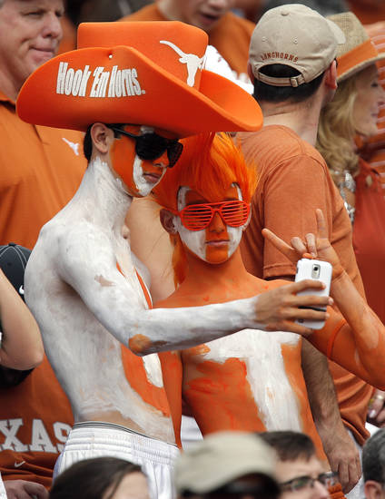Texas fans take their photo during the Red River Rivalry college football game between the University of Oklahoma (OU) and the University of Texas (UT) at the Cotton Bowl in Dallas, Saturday, Oct. 13, 2012. Photo by Chris Landsberger, The Oklahoman