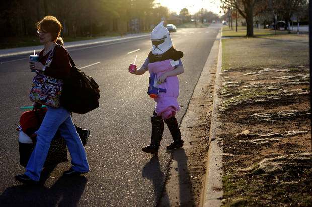 Ashleigh Carel, 12, of Blanchard, walks behind her mother, Sherria Carel, on their way into Science Museum Oklahoma for the Bright Night of Star Wars sleepover.