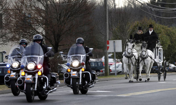 A horse drawn carriage carrying the body of Anna Grace Marquez-Greene leaves the church after her funeral in Bloomfield, Conn., Saturday, Dec. 22, 2012.  Marquez-Greene, 6,  was killed when gunman Adam Lanza opened fire at Sandy Hook Elementary School last week, killing 26 people, including 20 children, before killing himself. (AP Photo/Seth Wenig) ORG XMIT: CTSW111