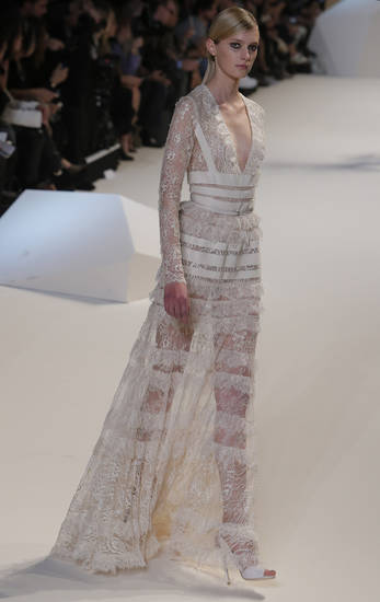 A model wears a creation by designer Elie Saab as part of his ready to wear Spring-Summer 2013 collection, in Paris, Wednesday, Oct. 3, 2012. (AP Photo/Francois Mori)