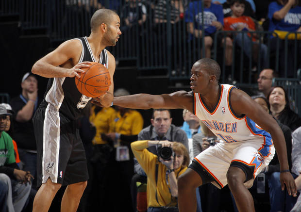 Oklahoma City Thunder's Reggie Jackson (15) defends San Antonio Spurs' Tony Parker (9) during the the NBA basketball game between the Oklahoma City Thunder and the San Antonio Spurs at the Chesapeake Energy Arena in Oklahoma City, Sunday, Jan. 8, 2012. Photo by Sarah Phipps, The Oklahoman