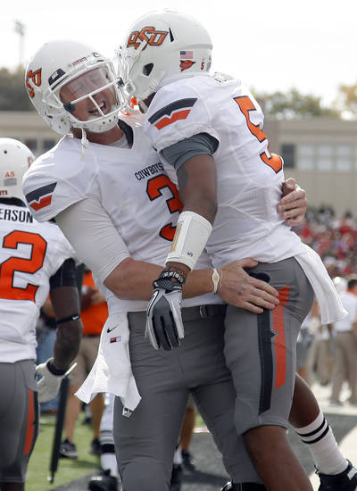 Oklahoma State Cowboys's Brandon Weeden (3) and Josh Stewart (5) celebrate a Stewart touchdown during a college football game between Texas Tech University (TTU) and Oklahoma State University (OSU) at Jones AT&T Stadium in Lubbock, Texas, Saturday, Nov. 12, 2011.  Photo by Sarah Phipps, The Oklahoman  ORG XMIT: KOD