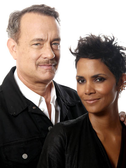 "In this Oct. 14, 2012 photo, actors Tom Hanks, left, and Halle Berry, from the upcoming film ""Cloud Atlas,"" pose for a portrait in Beverly Hills, Calif. The stars of �Cloud Atlas,"" along with British author David Mitchell, who wrote the novel that inspired the genre-bending epic about souls returning and intertwining over the centuries, shared their beliefs and disbeliefs about reincarnation as the film heads to U.S. theaters Oct. 26, 2012. Hanks himself doesn't buy into reincarnation, while Berry, Whishaw, Mitchell, Sarandon and co-stars Hugo Weaving and Jim Sturgess either believe or at least think it's possible that souls come back for an encore. (Photo by Matt Sayles/Invision/AP)) ORG XMIT: CAENT409"