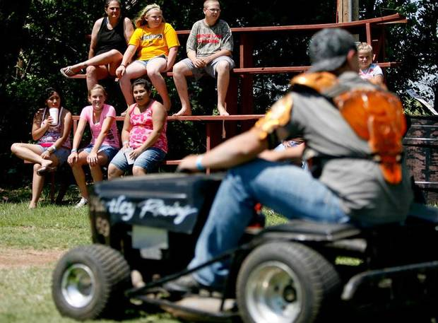 Fans watch as riders line up to enter the track during the El Reno Grascar Association lawn mower race in El Reno, Saturday, June 6, 2009. Photo by Bryan Terry, The Oklahoman