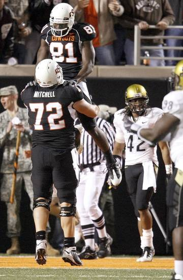 OSU's Justin Blackmon celebrates with Andrew Mitchell in front of Colorado's Benjamin Burney after Blackmon scored a touchdown in the fourth quarter of the college football game between Oklahoma State University (OSU) and the University of Colorado (CU) at Boone Pickens Stadium in Stillwater, Okla., Thursday, Nov. 19, 2009. Photo by Bryan Terry, The Oklahoman