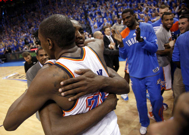 Oklahoma City's Kevin Durant (35) and Serge Ibaka (9) celebrate their win during game one of the first round in the NBA playoffs between the Oklahoma City Thunder and the Dallas Mavericks at Chesapeake Energy Arena in Oklahoma City, Saturday, April 28, 2012. Photo by Sarah Phipps, The Oklahoman
