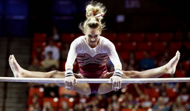 Hayden Ward competes in the uneven bars as the University of Oklahoma Sooners (OU) compete at the NCAA, Women's Gymnastics Regional at The Lloyd Noble Center on Saturday, April 6, 2013  in Norman, Okla. Photo by Steve Sisney, The Oklahoman