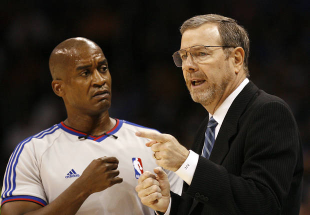 Thunder coach P.J. Carlesimo talks with the official during the NBA basketball game between the Oklahoma City Thunder and the Milwaukee Bucks at the Ford Center in Oklahoma City, Wednesday, Oct. 29, 2008. This was the regular season debut of the Thunder. BY NATE BILLINGS, THE OKLAHOMAN