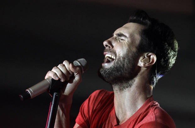 "FILE - This Nov. 16, 2011 file photo shows musician Adam Levine, of Maroon 5, performing with the band at the Google and T-Mobile party celebrating the launch of Google Music in Los Angeles. The latest release by Maroon 5, ""Overexposed,"" was released on Tuesday, June 26. (AP Photo/Matt Sayles, file)"
