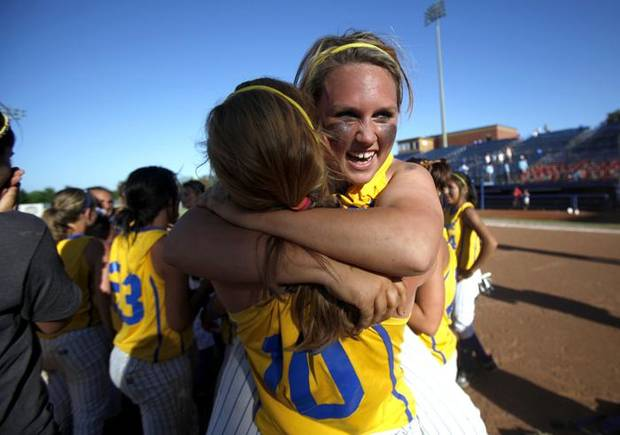 Bethel's Makayla Green, right, and Megan Acklin celebrate following  the Class 5A slow-pitch high school softball state championship game between Bethel and Purcell, Wednesday, May 5, 2010, at ASA Hall of Fame Stadium in Oklahoma City. Photo by Sarah Phipps, The Oklahoman.       ORG XMIT: KOD