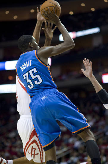Oklahoma City Thunder's Kevin Durant (35) puts up a shot against the Houston Rockets in the first half of an NBA basketball game Sunday, Nov. 28, 2010, in Houston, (AP Photo/Steve Ueckert)