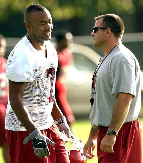 Norman, Thursday, August 7, 2003.       UNIVERSITY OF OKLAHOMA COLLEGE FOOTBALL: OU's #7 Brandon Everage talks with OU's strength coach Jerry Schmidt  before practice Thursday morning at the intramural fields in Norman. Oklahoman staff Photo by Ty Russell.