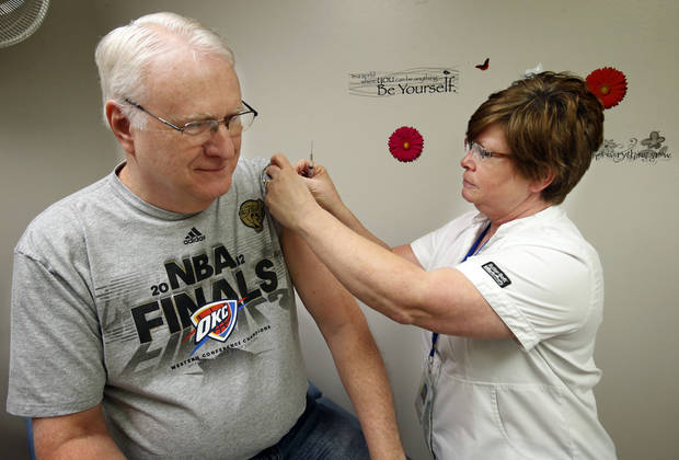 George Henschel gets a flu shot from nurse D.J. Gentry at the Cleveland County Health Department. PHOTO BY STEVE SISNEY, THE OKLAHOMAN <strong>STEVE SISNEY</strong>