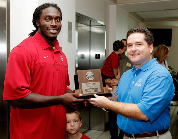"OU defensive back Quinton Carter was named to the AFCA Good Works team on Tuesday. Carter was surprised with the award by a class of children Carter ""adopted"" from a local KinderCare day care. PHOTO COURTESY OU SPORTS INFORMATION"