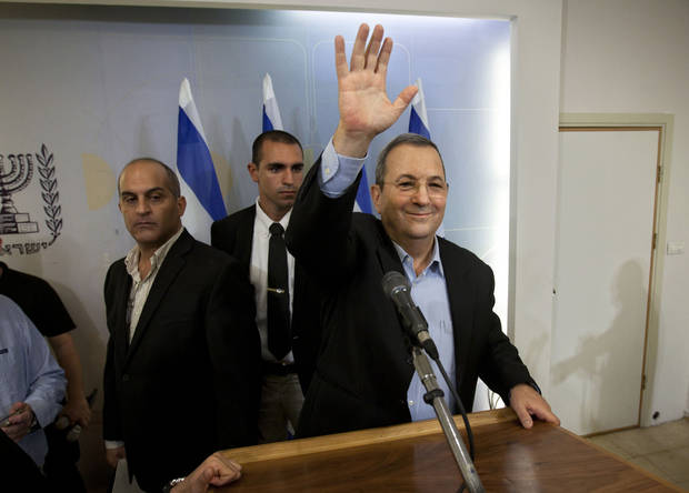 Israeli Defense Minister Ehud Barak waves to media after a conference in Tel Aviv, Monday, Nov. 26, 2012. Barak shook up the Israeli political system Monday with the abrupt announcement that he is quitting politics and will not run in general elections in January. The defense minister made the surprise announcement even after polls showed his breakaway Independence Party gaining momentum after Israel's recent military offensive in the Gaza Strip. (AP Photo/Oded Balilty)