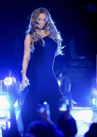 Singer Mariah Carey performs at Caesars Entertainment &quot;Escape to Total Rewards&quot; kick-off at Gotham Hall on Thursday, March 1, 2012 in New York. (AP Photo/Evan Agostini)