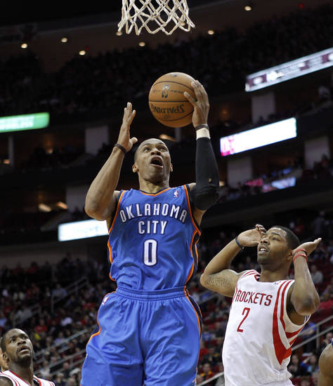 Oklahoma City Thunder guard Russell Westbrook (0) drives to the basket past Houston Rockets forward Marcus Morris (2) during the first half of an NBA basketball game, Saturday, Dec. 29, 2012, in Houston. (AP Photo/Bob Levey)