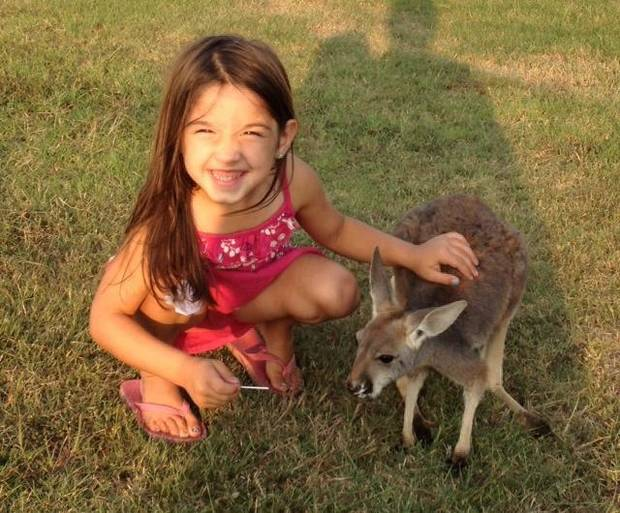 This photo of 4-year-old Layla Menhusen with her pet kangaroo Lucy Sparkles was taken in October. The kangaroo went missing from the family's home north of Shawnee on Thanksgiving evening. <strong> - photo provided</strong>