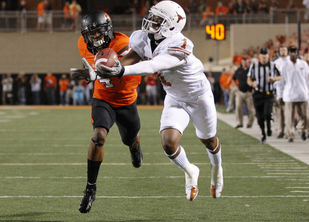 Texas' Mike Davis (1) cant's hold on for the catch in front of Oklahoma State's Justin Gilbert (4) during a college football game between Oklahoma State University (OSU) and the University of Texas (UT) at Boone Pickens Stadium in Stillwater, Okla., Saturday, Sept. 29, 2012. Oklahoma State lost 41-36. Photo by Bryan Terry, The Oklahoman