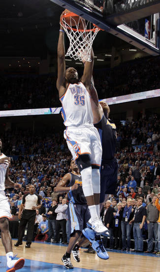 Oklahoma City's Kevin Durant (35) ties the game with a dunk as Denver's Chris Andersen (11) defends during the NBA basketball game between the Oklahoma City Thunder and the Denver Nuggets at the Chesapeake Energy Arena, Sunday, Feb. 19, 2012. Photo by Sarah Phipps, The Oklahoman