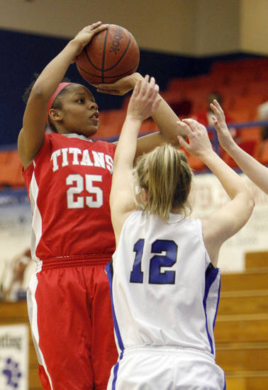 Carl Albert's Gioya Carter shoots over Harrah's Sydney Hessman during the Titans' win Tuesday. PHOTO BY SARAH PHIPPS, THE OKLAHOMAN