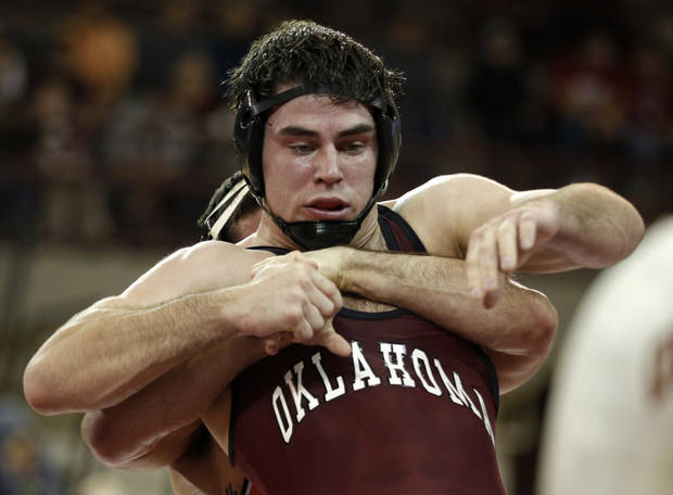 OU's Bubby Graham wrestles OSU's Tyler Caldwell during the wrestling match between Oklahoma University and Oklahoma State University at McCasland Field House in Norman, Okla.,Sunday, Dec. 9, 2012.  Photo by Garett Fisbeck, For The Oklahoman