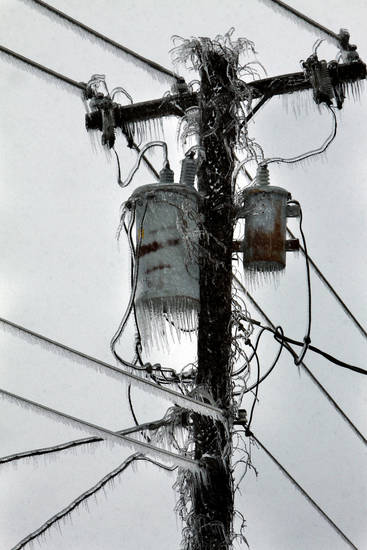 A power transformer in a residential neighborhood testifies to the amount of moisture that fell during a winter storm.  Most of the town was still without power on Friday, Jan. 29, 2010, in Purcell, Okla.  Photo by Steve Sisney, The Oklahoman